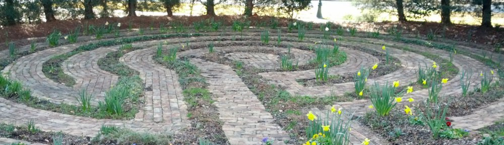 header image Mt Vernon Rd Labyrinth brick path with yellow flowers and green grass